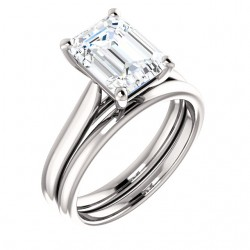 Halia cathedral solitaire, shown here with a 9x7mm emerald cut center and optional but available matching band.