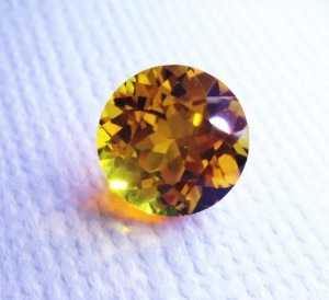 Golden Yellow Avarra sapphire, shown here in an 8mm sapphire cut round.
