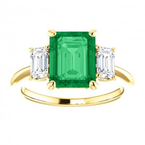 Firande 3 Stone Ring, in 14kt yellow gold with an 8x10mm emerald center (not included, but we do offer Avarra lab-grown emeralds in emerald cut!).  Ring size approximately a 7.