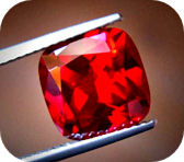 Cushion cut photo of our Avarra lab ruby photo courtesy of Jean Claude Levandowski