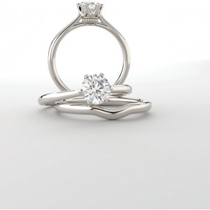 Coronet Solitaire Ring shown here with optional but available matching band.  Center stone is a 6.5mm round.