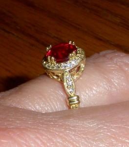 7mm Round Diamond Cut Avarra™ Lab Grown Ruby in customer sourced setting