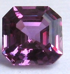 Customer photo of a 7mm Asscher cut Purple-Pink Avarra sapphire.