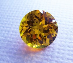 Golden Yellow Avarra sapphire, shown here in an 8mm sapphire cut round.