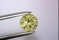 Avarra Lemon Yellow Lab Sapphire: Concave Round Cut